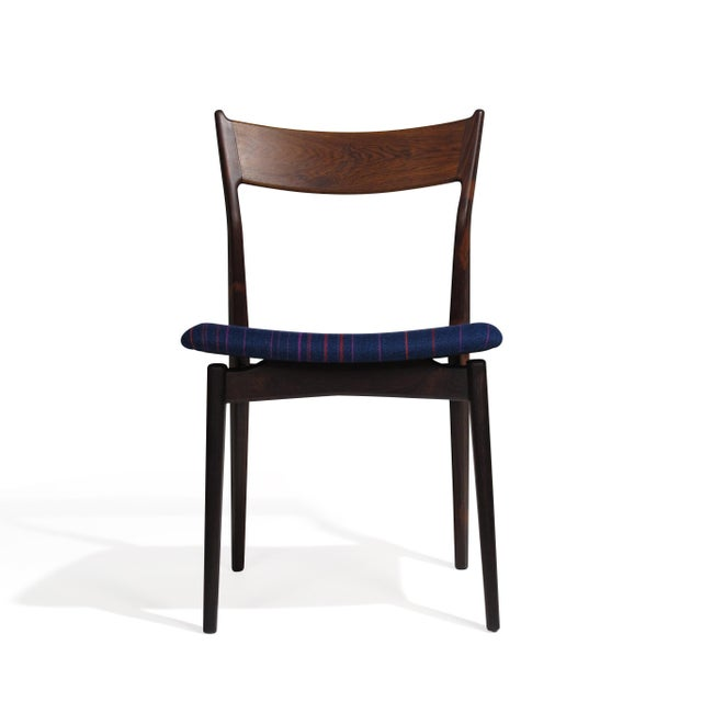 Mid Century Brazilian Rosewood dining chairs designed by H.P. Hansen for Randers Mobelfabrik. Handcrafted of solid...