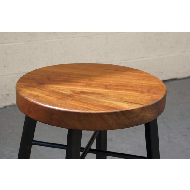 It's a beauty! Our custom stool pairs reclaimed tiger wood and steel. Industrial yet elegant, with an organic twist....