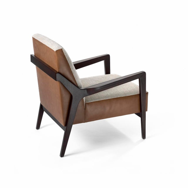The Justin Club chair is hand made-to-order in the USA and features brass inlayed armrests. The Justin is available in a...