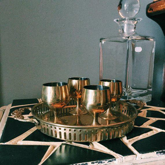 Get this unique and gorgeous solid brass set of 4 cordials for your bar cart! Tray not included. Handmade in India.