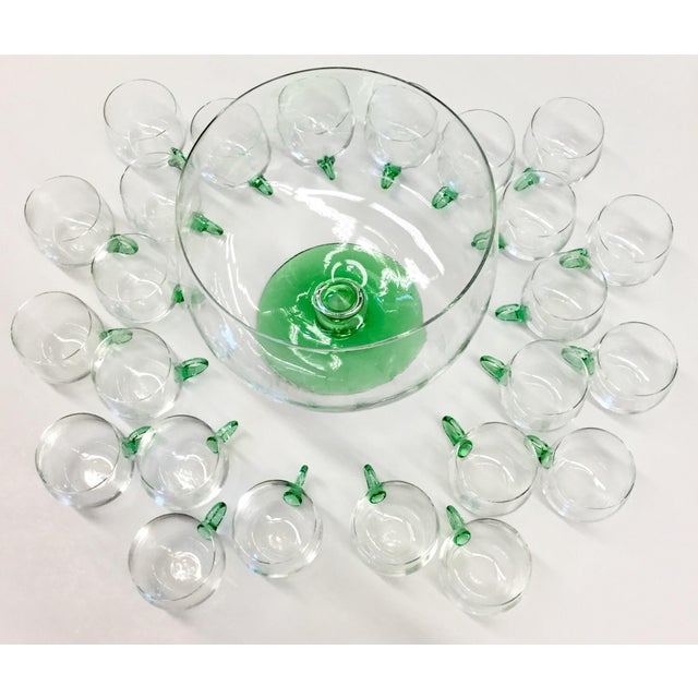 Magnificent and extremely rare set of 24 punch cups and serving bowl. The huge bowl sits on a stem made of hand blown...