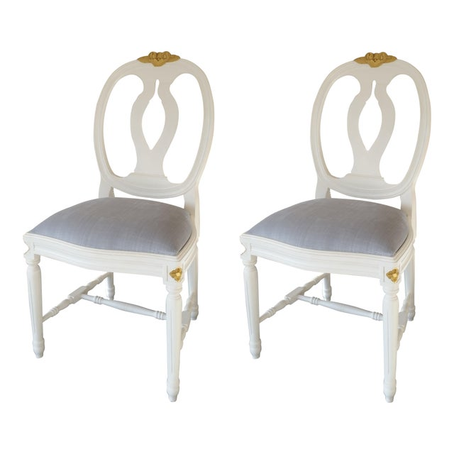 A pair of Gustavian chairs with rose carvings Gold detailing to top rose carving and petal details on leg corners Antique...