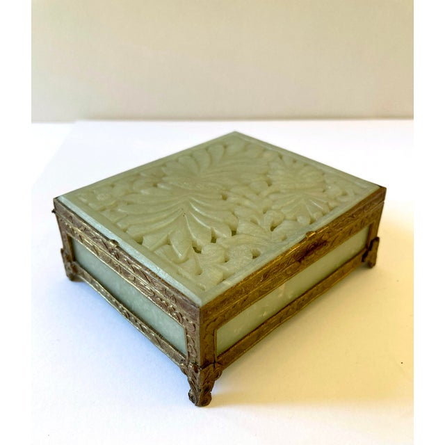 A lovely, antique, Chinese, green jade box with decorative brass surround. Marked China