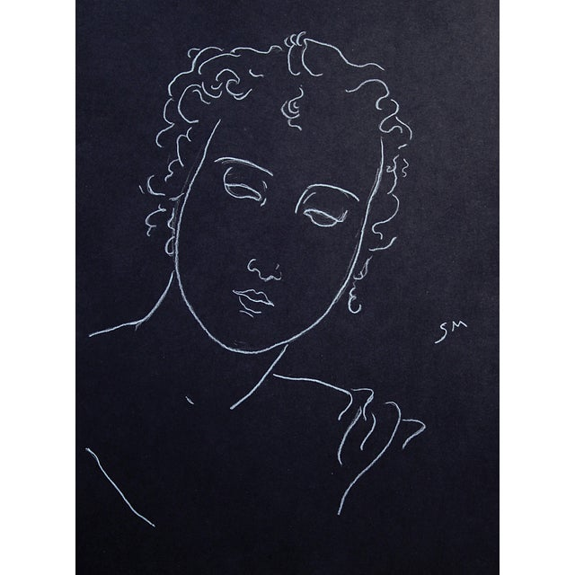 Simple, definite lines of white charcoal contrast with the deep black paper. Combining with the gentle face and pensive...