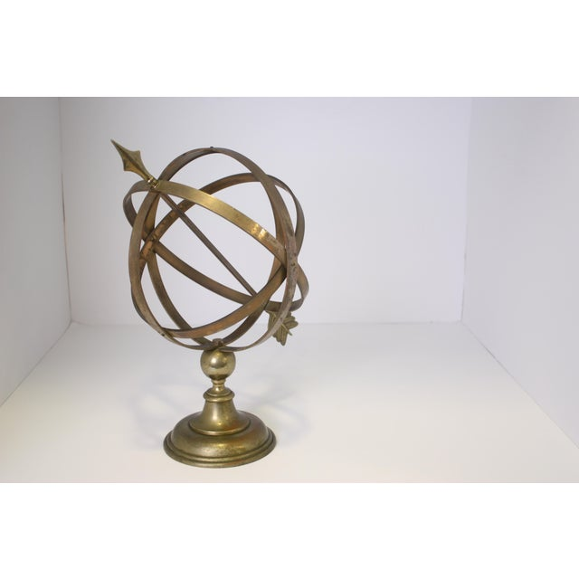 Handsome Armillary Sphere(globe) consisting of solid brass metal on a round brass base with three rings representing lines...