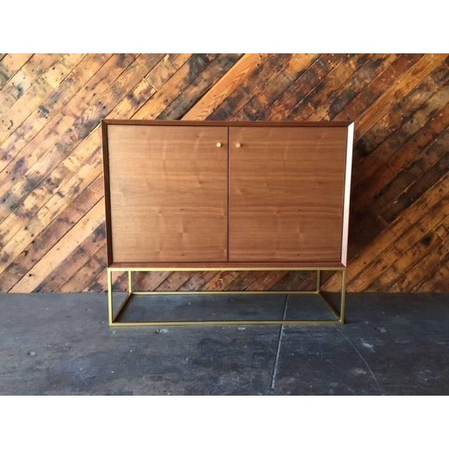 Newly handmade, walnut wood, brass base, front open doors, plenty of interior shelving for storage, can be made in custom...