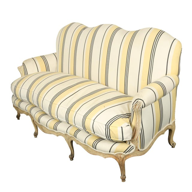French Louis XVI Jansen style striped sofa with camel back