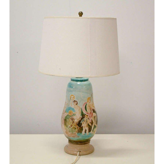 Italy Circa 1940 A rare ceramic lamp depicting nymphs and satyrs by master sculptor and potter Professor Eugenio...