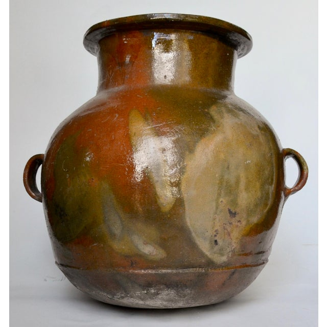 Beautiful large early 1900s Guatemalan terracotta water jug with beautiful green and creams coming through the glaze....