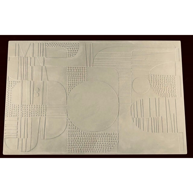 Waxed plaster coffee table with white powder coated metal base. Abstract pattern Is based on a 1930s French Motif. Sealed....