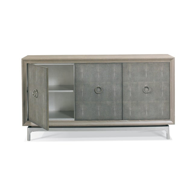 The Harper Sideboard Mid-century style sideboard with an ash solids and veneers three door case seemingly floating on a...