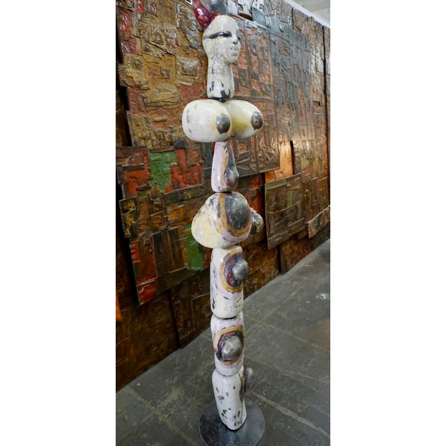 Abstract female nude composed of 7 sections, mounted on a steel rod. Glazed ceramic,hand made and signed.