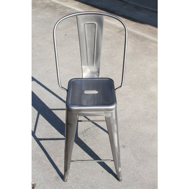 This is a GENUINE Tolix Marais counter stool with a high back in a gunmetal finish. These are NOT Tolix style knockoffs...