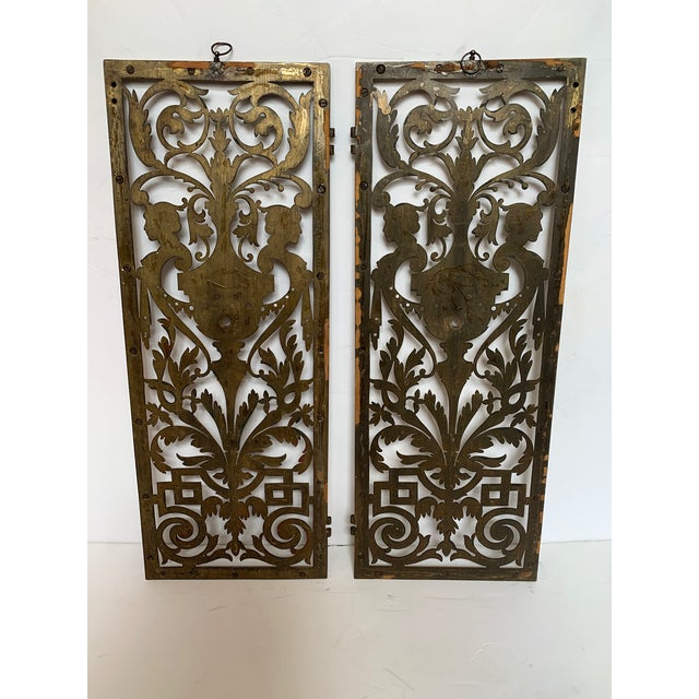 Beautiful pair of rectangular vintage etched and cut out brass panels having figural busts, urns and curlicues in an...