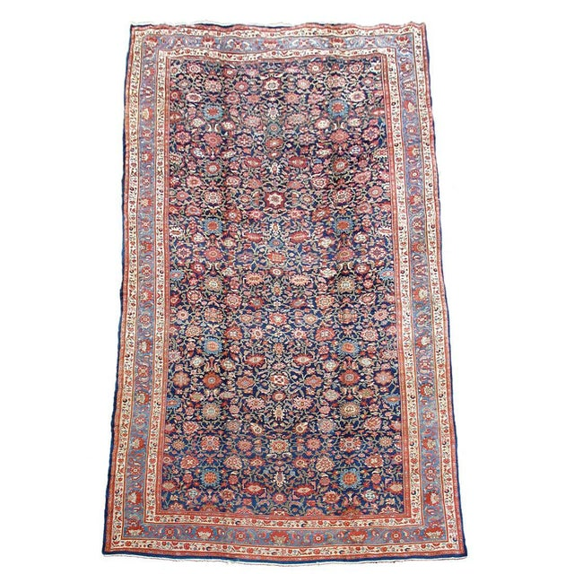 Large palace-sized Hamadan carpets of this scale are rare and it is probable that this piece was commissioned for a...