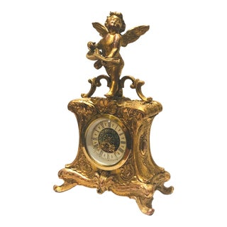 Antique Gilt Metal Mantle Clock With Cherub Statuette For Sale