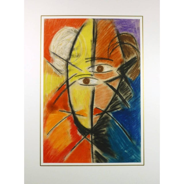 Vibrant French cubist face oil pastel painting in bold colors of yellow, orange and blues, circa 1960. Original artwork on...