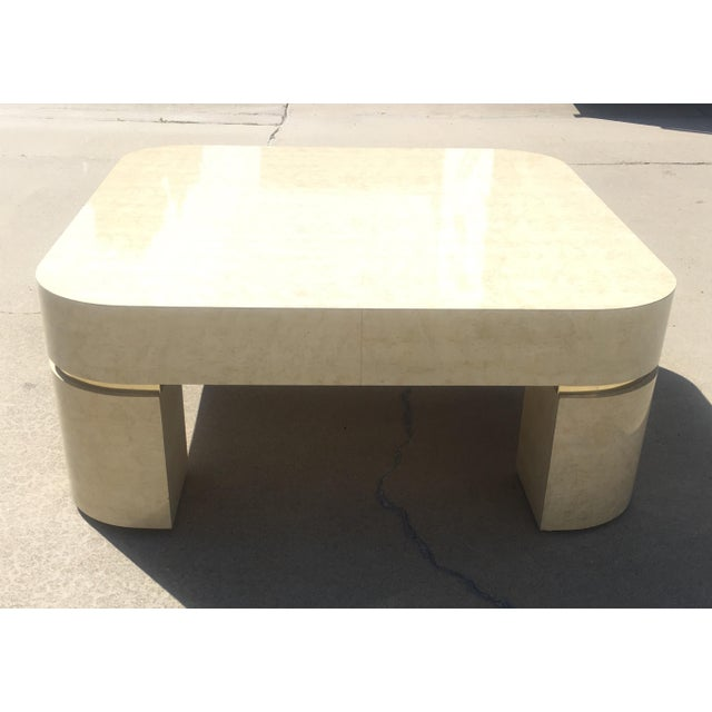 Karl springer style coffee table. Faux goat skin with brass metal accents.