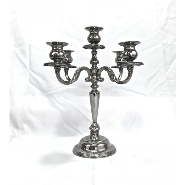 Four-arm five sconce silver plate heavy weighted candelabra. A very classy accent for any holiday tablescape.