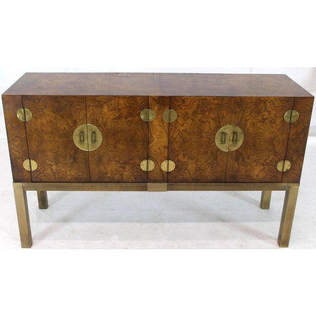 Compact rectangular shape Mid-Century Modern burl wood credenza cabinet. Vivid burl wood pattern. Large oversize brass...