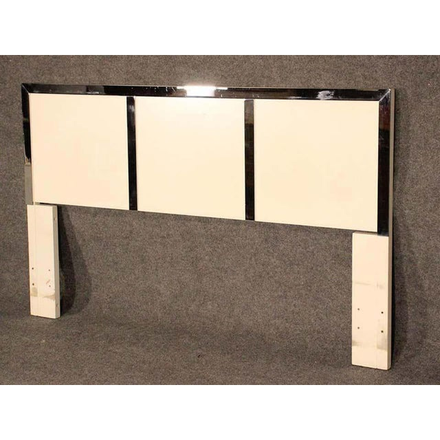 Mid-Century Modern white headboard with polished chrome trim. (Please confirm item location - NY or NJ - with dealer)....