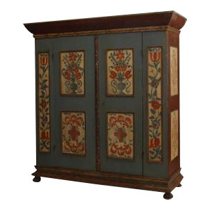 American 18th Cent (German) blue/grey painted armoire (Kas) cabinet resting on bun feet with 2 large center doors and decorated with panels with a flo For Sale