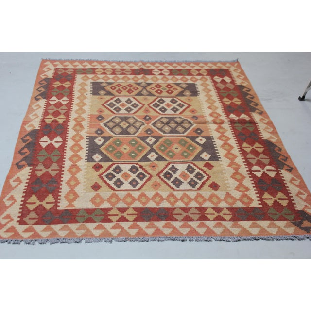 This beautiful traditional kilim, handmade by Aara Rugs. Geometric design. This kilim is made of 100% wool, dyed with all...