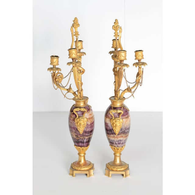 Neoclassical / Louis XVI-style gilt bronze mounted Blue John candelabra with Bacchus masks as handles each side, three (3)...