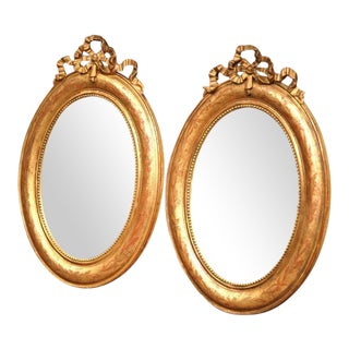 18th Century French Louis XVI Oval Gilt Ribbon Bow Mirrors - a Pair For Sale