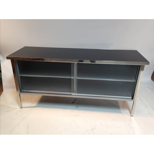 Vintage 1960's Steelcase credenza, expertly restored and given new life! The steel body and legs have been stripped of the...