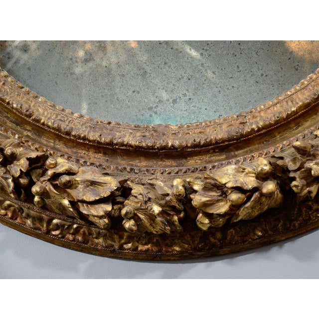 19th century carved wood and gesso gilt mirror.