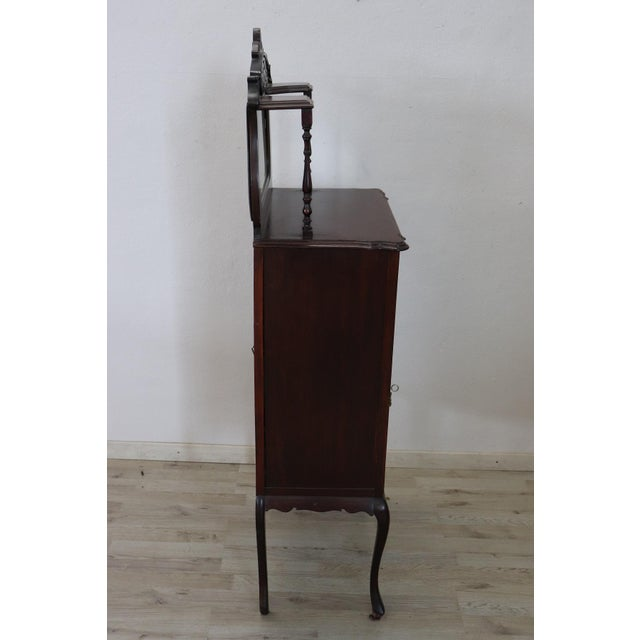 Antique English Vitrine 1880s in mahogany wood. Important mahogany wood carving with decorations moved. Perfect for...