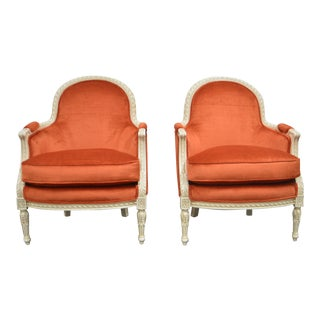 Pair of Louis XVI Style Painted Bergere Chairs Newly Uphostered in a Tangerine Velvet. For Sale