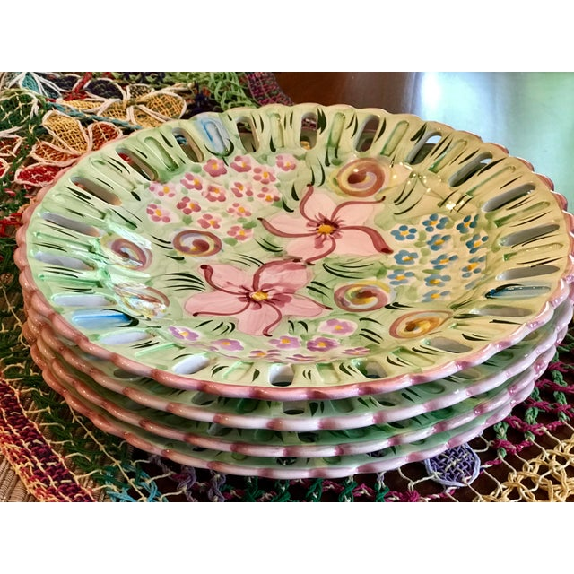 This set of 4 lovely hand-painted floral ceramic plates comes from a region in Portugal called Alcobaca. The area is a...