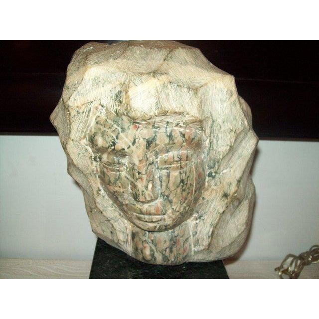 Modernist marble sculpture on granite base, signed Simon.
