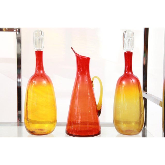 Remarkable 25 piece Blenko glass ensemble dating from the 1930s-1960s. These examples were designed by Wayne Husted and...