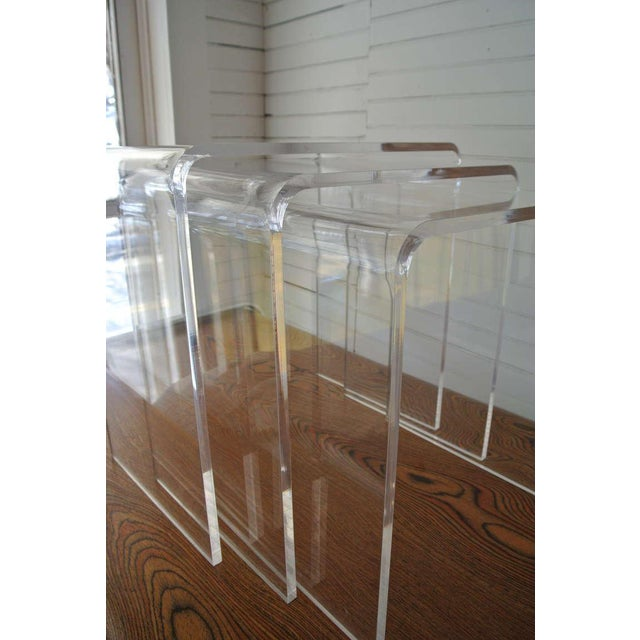 Excellent example of Lucite. The nesting tables have a smooth curves and are beautifully transparent.