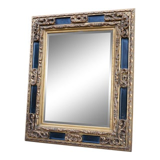 Carved Italian Ebonized Giltwood Mirror For Sale