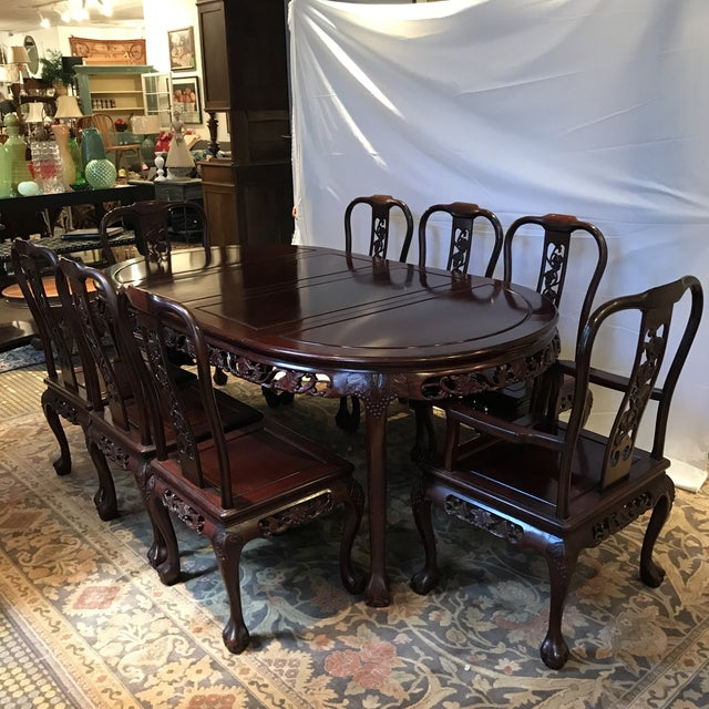 Amazing rosewood dining table and 8 chairs in the Ling Chi style. Very heavy and exquisitely carved detail. In excellent...