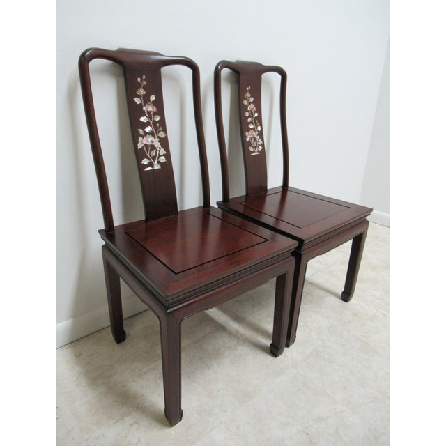 This is a pair of matching dining room chairs. They are made of rosewood and mother of pearl. Door to door delivery...