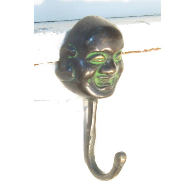 Heavy decorative bronze hook featuring happy Buddha. Easy to hang with any wall screw.