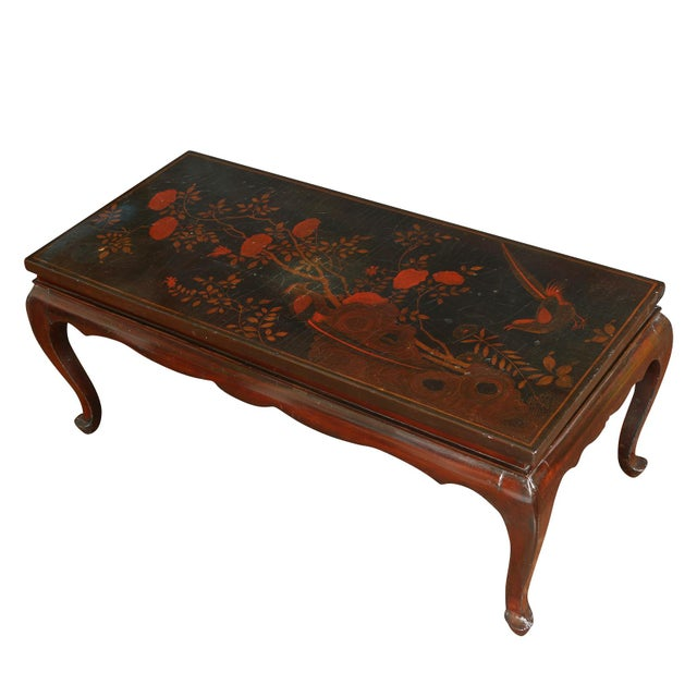 Antique chinoiserie lacquered low coffee table with red flower detail to top