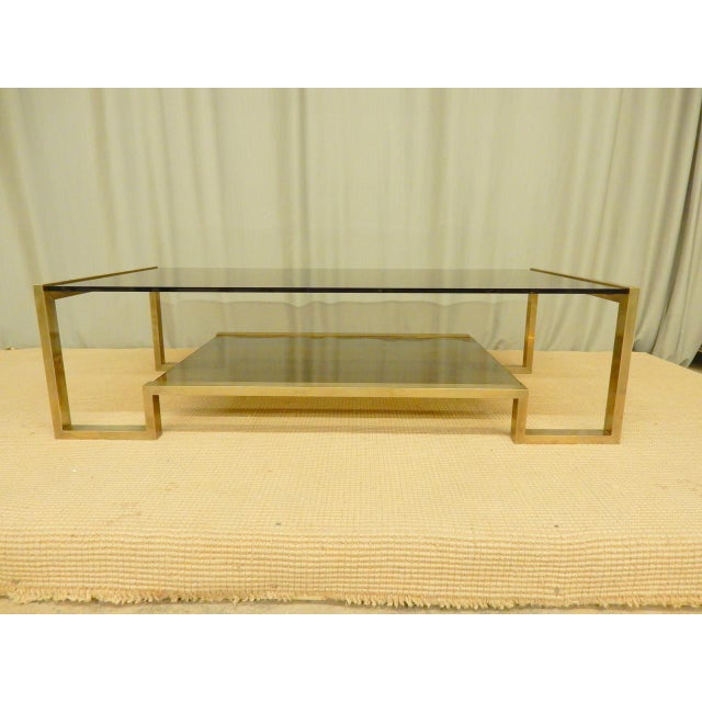 Guy Lefevre' Mid-Century brass and glass coffee table.