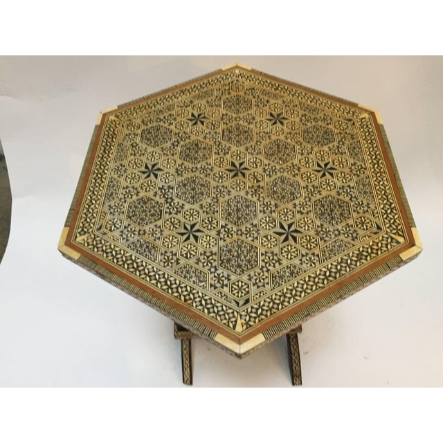 Egyptian octagonal side table, marquetry inlaid. Tilt-top table with Moorish Syrian intricate designs.