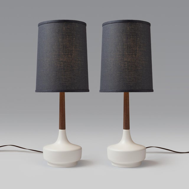 Pair of Mid-Century Inspired Table Lamps — Cream Ceramic Base, Walnut Neck, Grey Muslin Lampshade There is no doubt that...