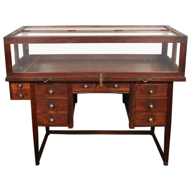 An unusual jewelers work desk and display case on stretcher base. This piece would look great in a den or dressing room.