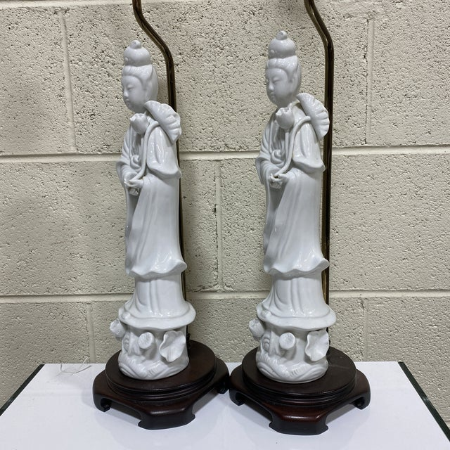 These are beautiful porcelain lamps by Seyei Fine China. Quan Yin figures mounted on wood Ming bases. Harp and finials...