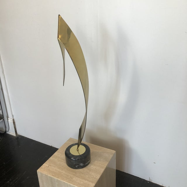 Elegant Brass Ribbon Sculpture with Marble Base by C. Jere. Wonderful scale to be shown on art pedestal!