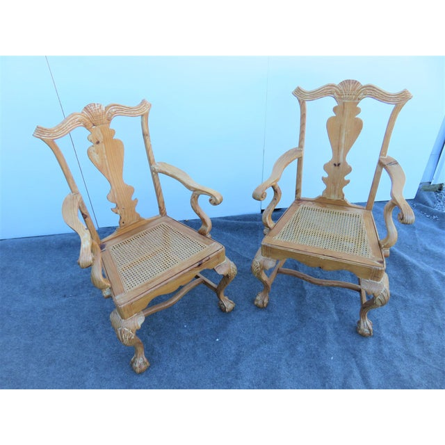 A pair of English Chippendale arm chairs, solid pine frames, carved claw and ball feet, caned seat, light dry brushed...