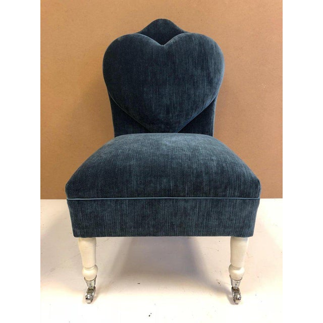 Pair of flavour custom design lounge / slipper chairs. Chairs have painted wood legs, front legs have caters and the...